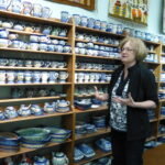 Joan Bittner explaining different types of Polish Pottery.