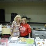 Rozanne and Carole dishing out the food.